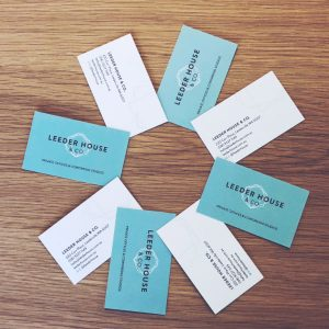 leeder House and co business cards displayed in a circle